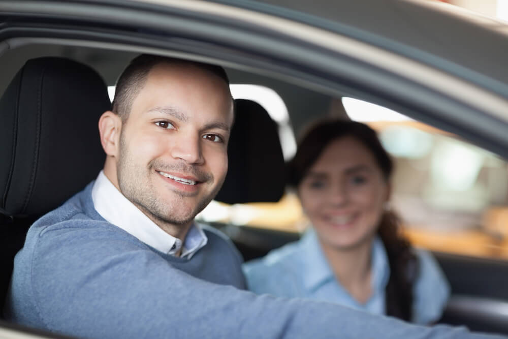 emergency car insurance couple driving