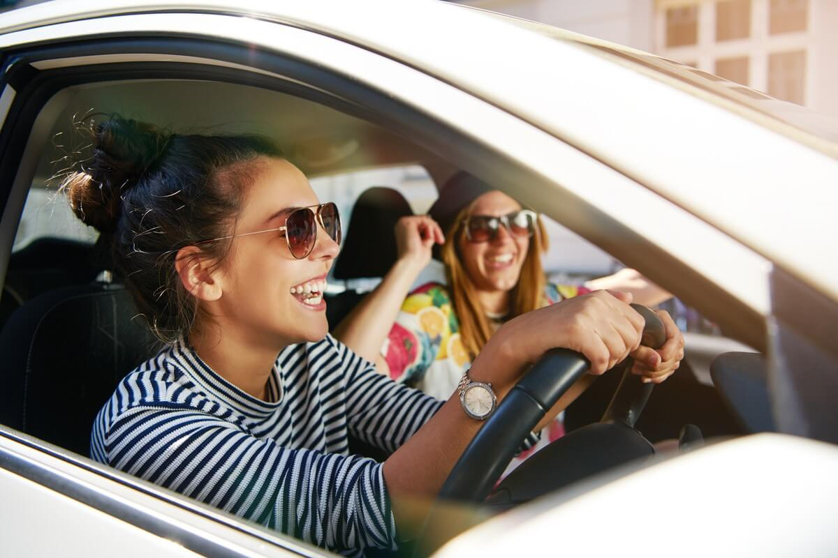 Two women in car laughing